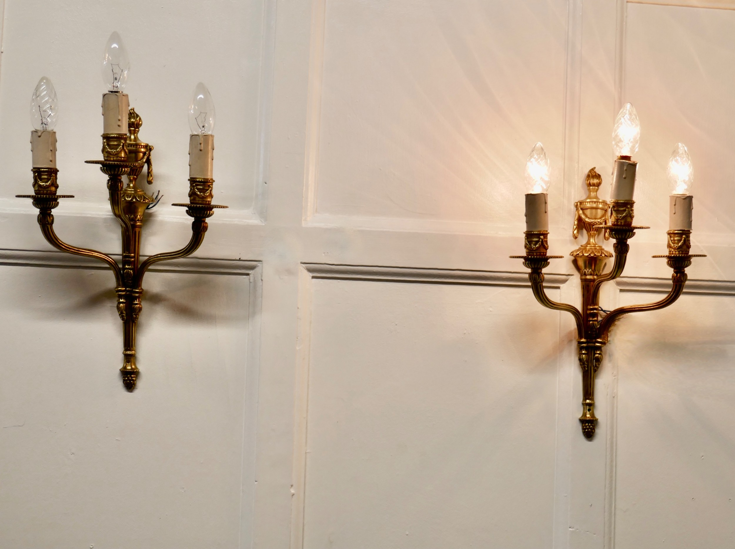 pair of french neo classical brass triple wall lights