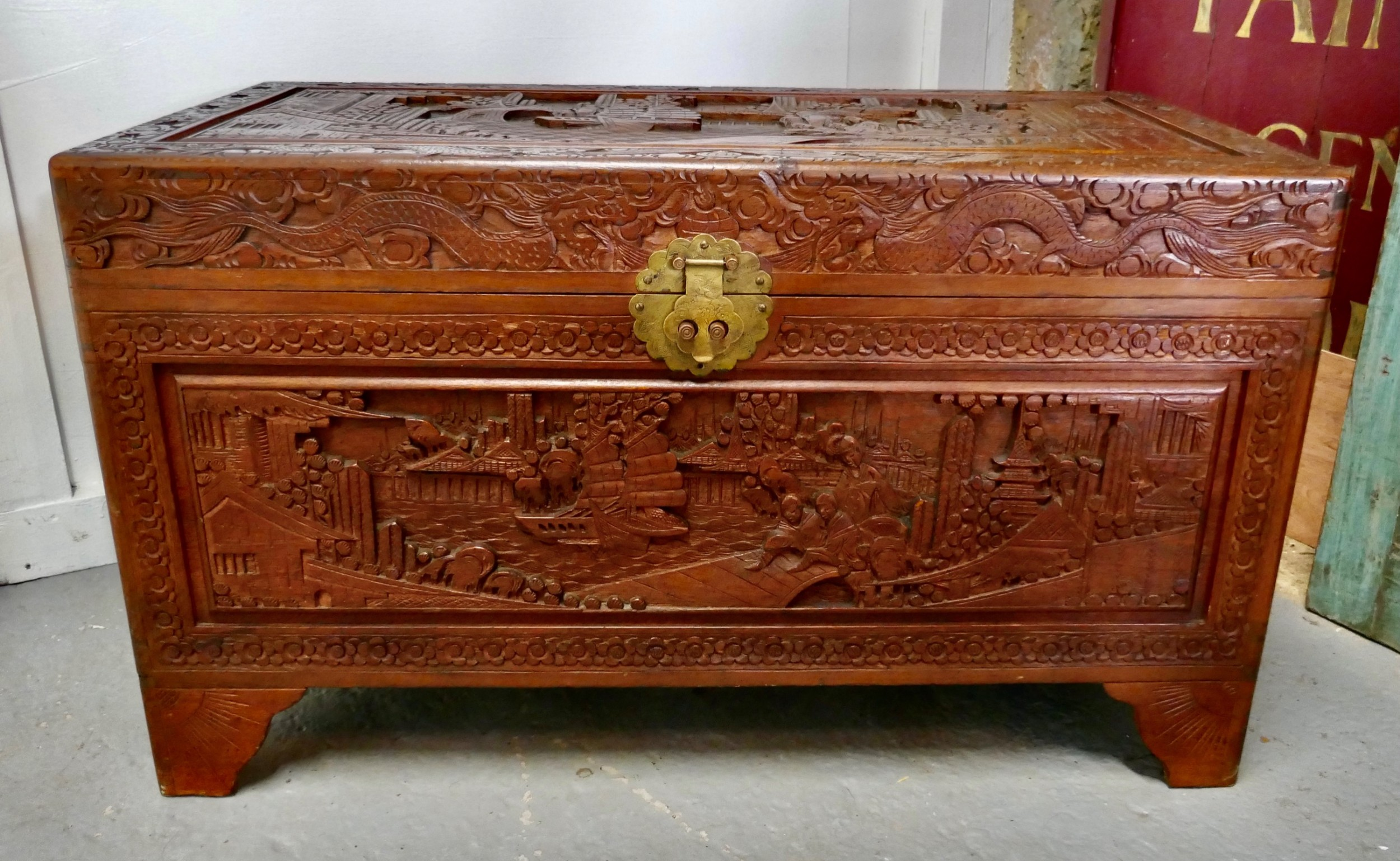 a carved oriental camphor wood chest