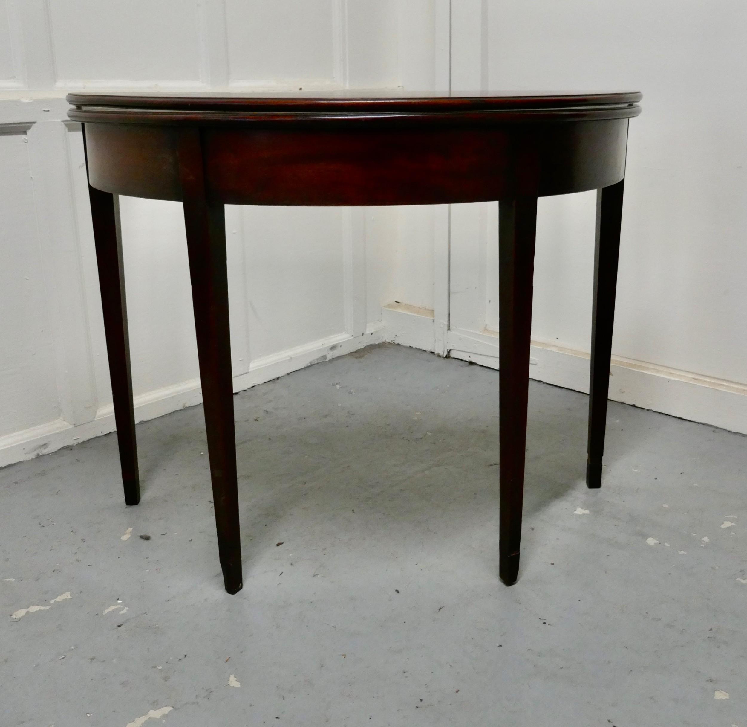 19th century mahogany demilune turn over top tea table