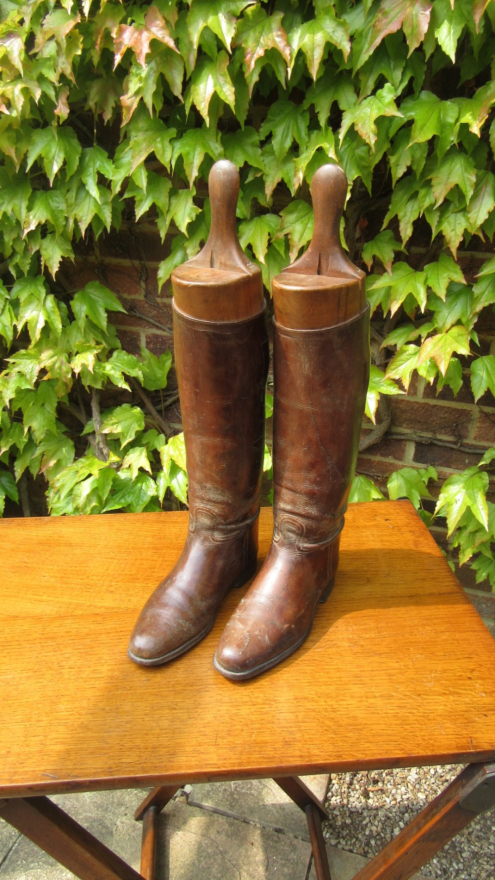 pair of antique brown leather riding boots