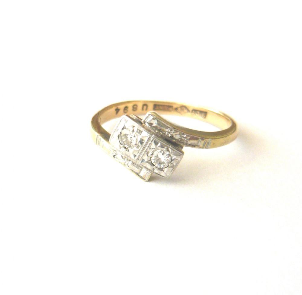 art deco two stone diamond crossover ring