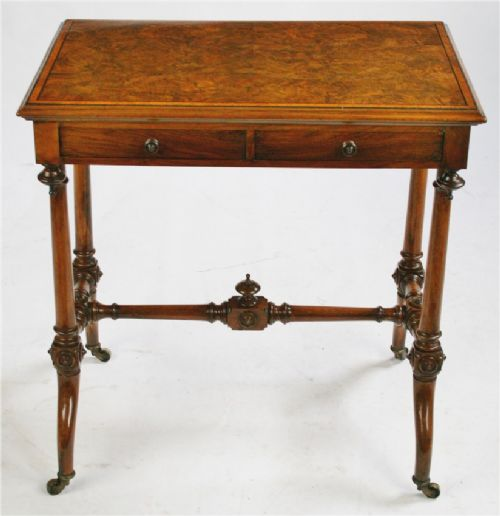 victorian figured walnut occasional centre table having 4 mahogany lined drawers