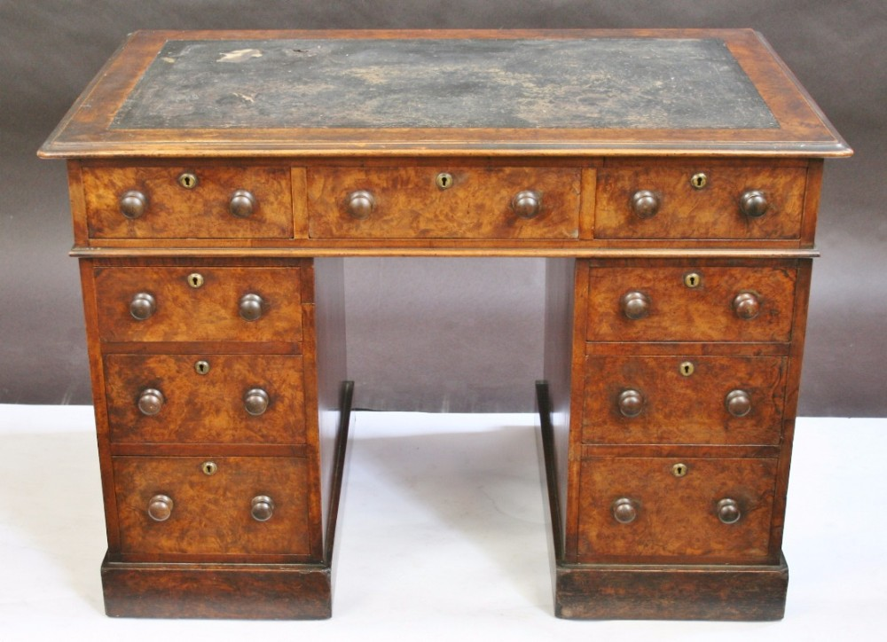 good quality victorian figured walnut small 3 part 9 drawer kneehole desk