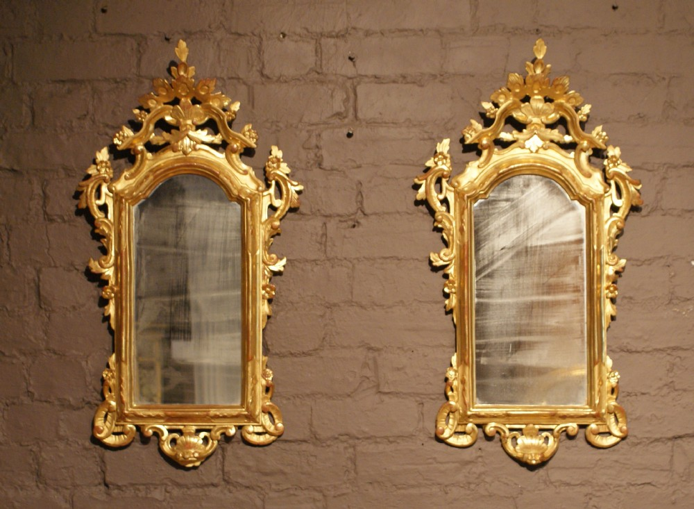 a pair of 19th century carved and water gilt italian portrait mirrors