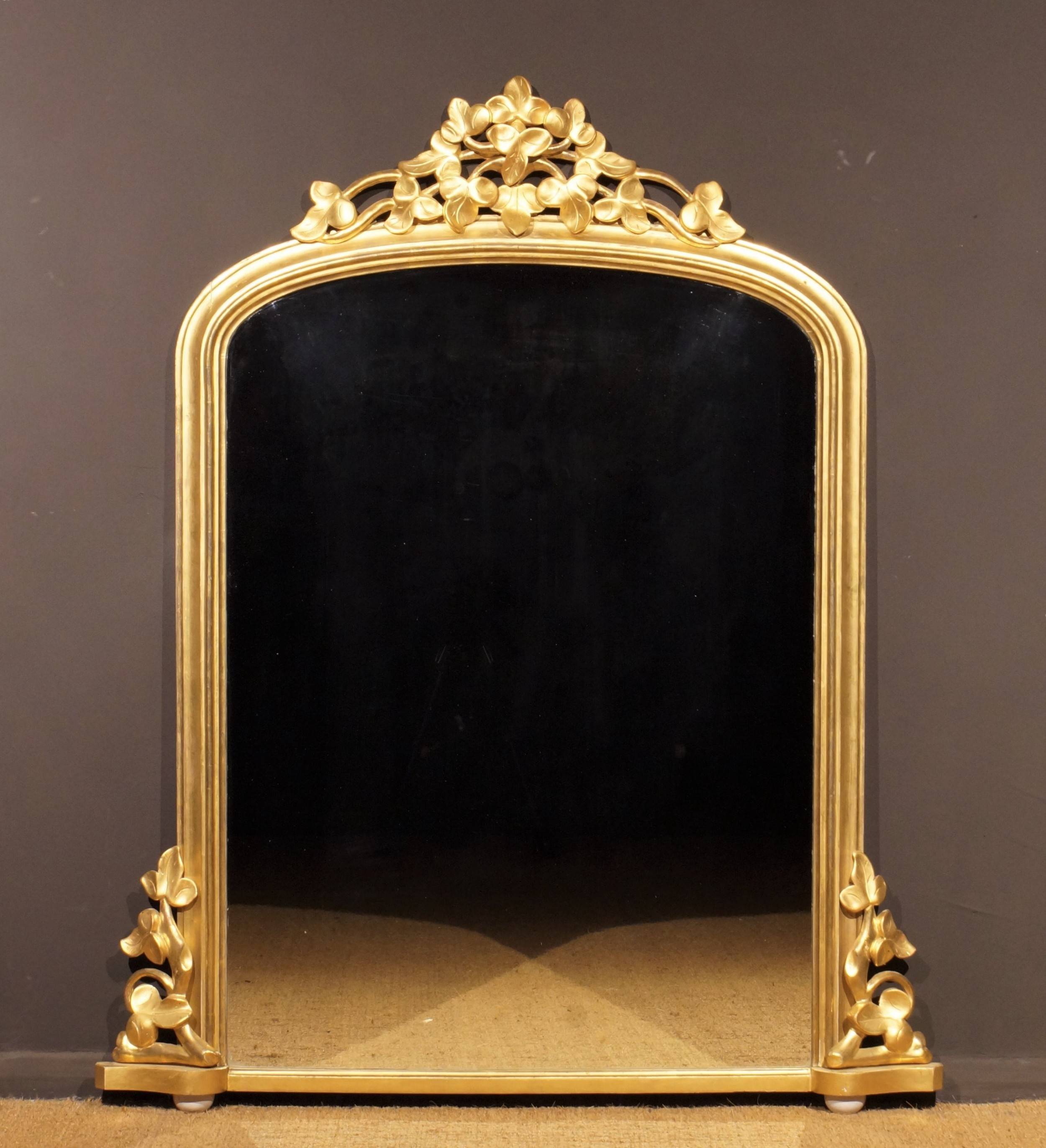 a mid 19th century giltwood overmantle mirror