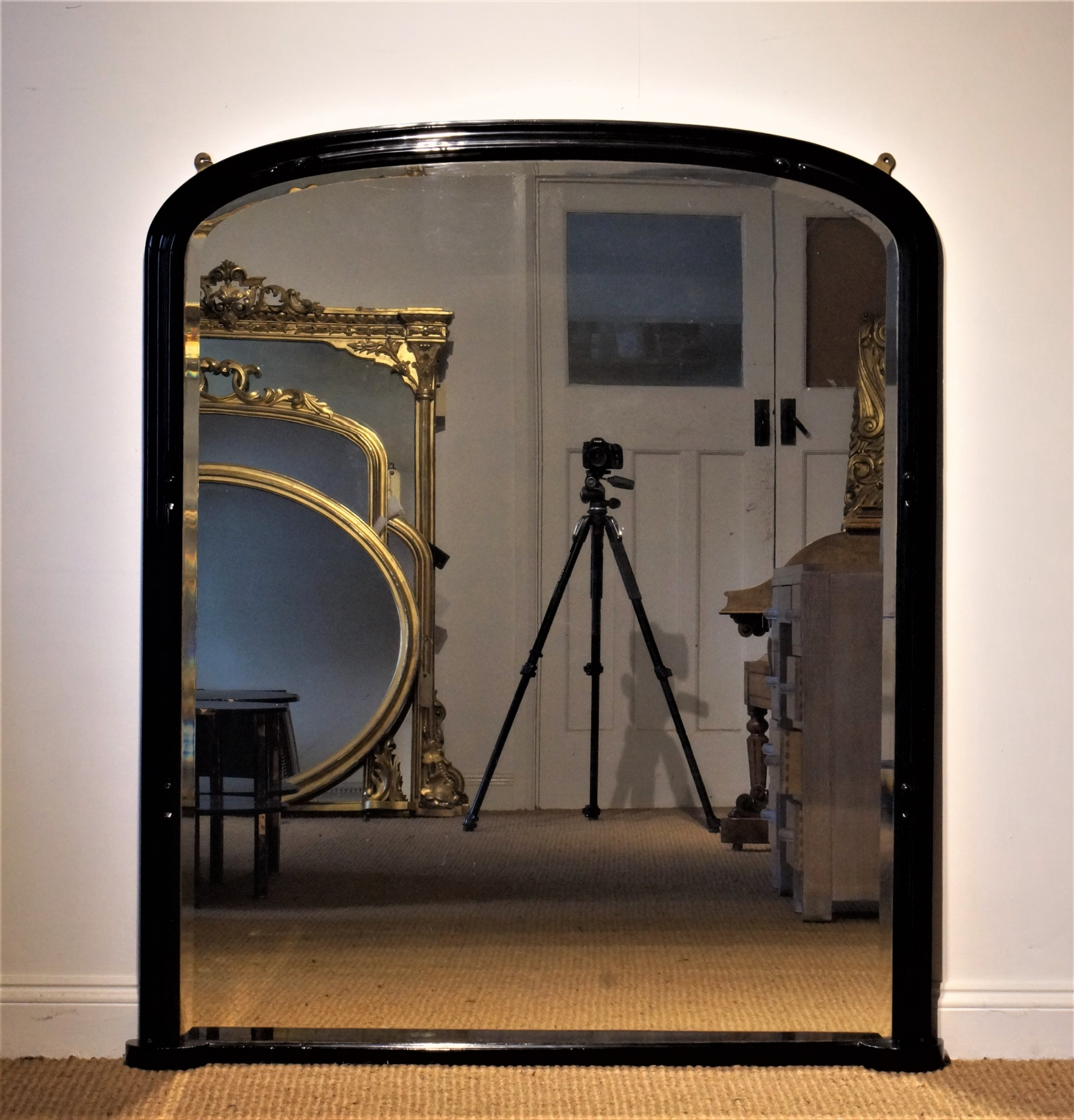 19th century arch top ebonized mirror