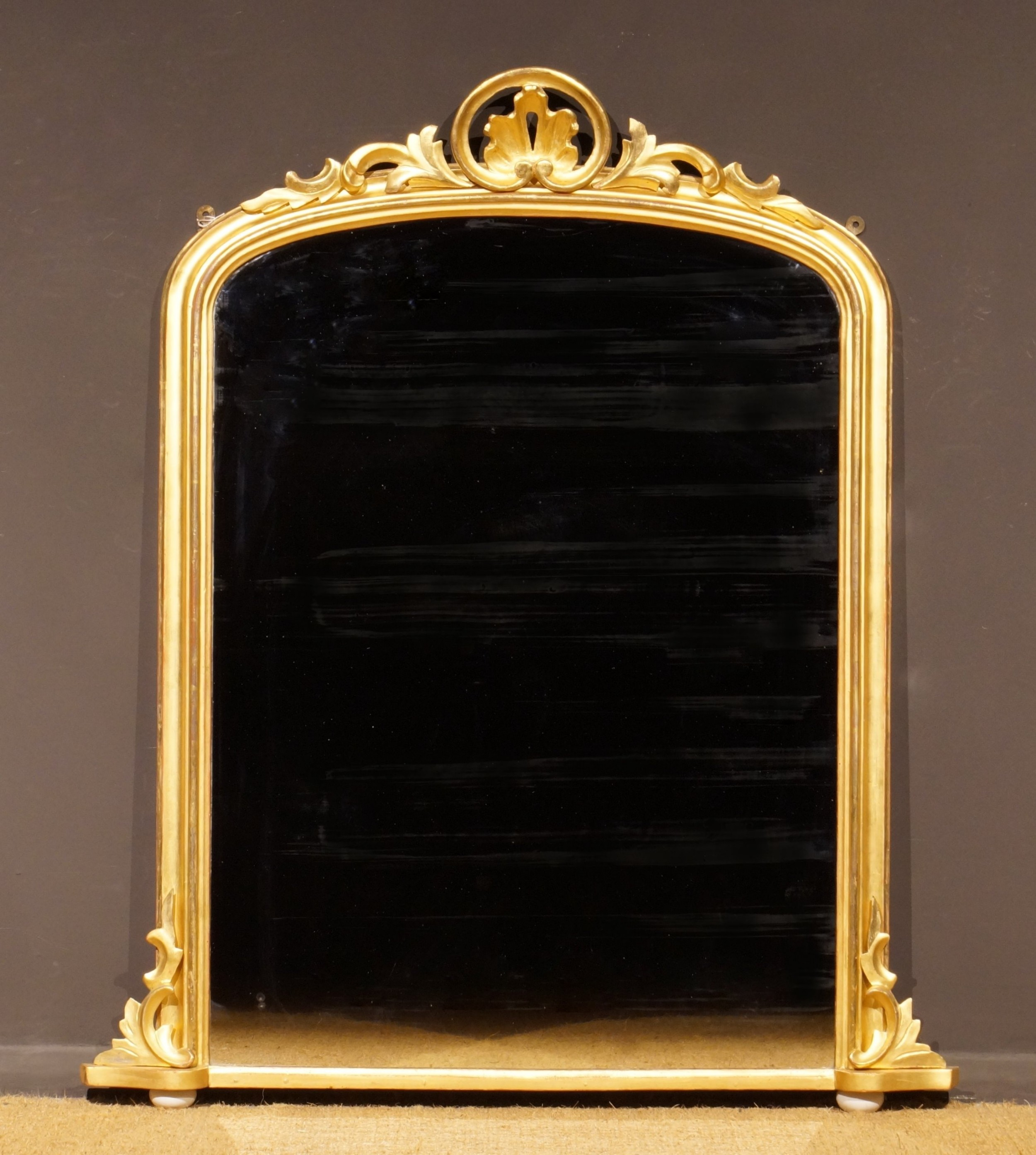 mid 19th century giltwood arch top mantle mirror