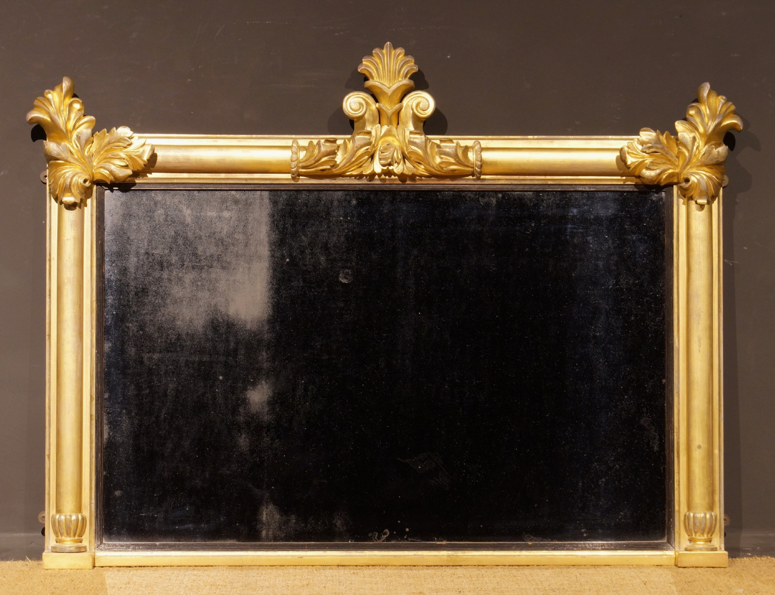 a 19th century carved wood and water gilt over mantle mirror after thomas king