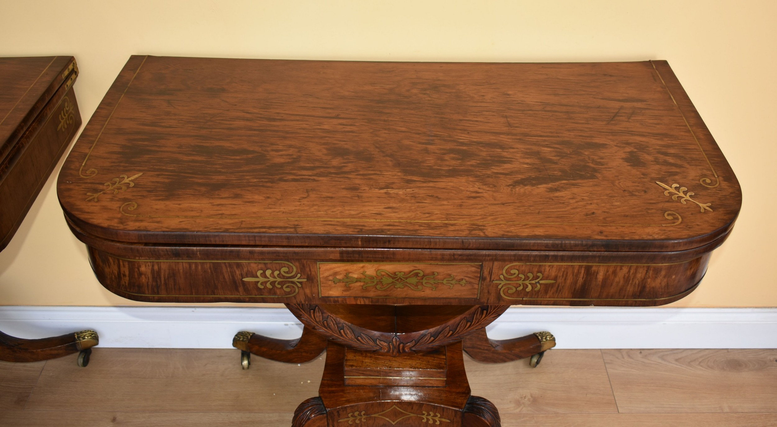 pair of regency rosewood brass inlaid card tables
