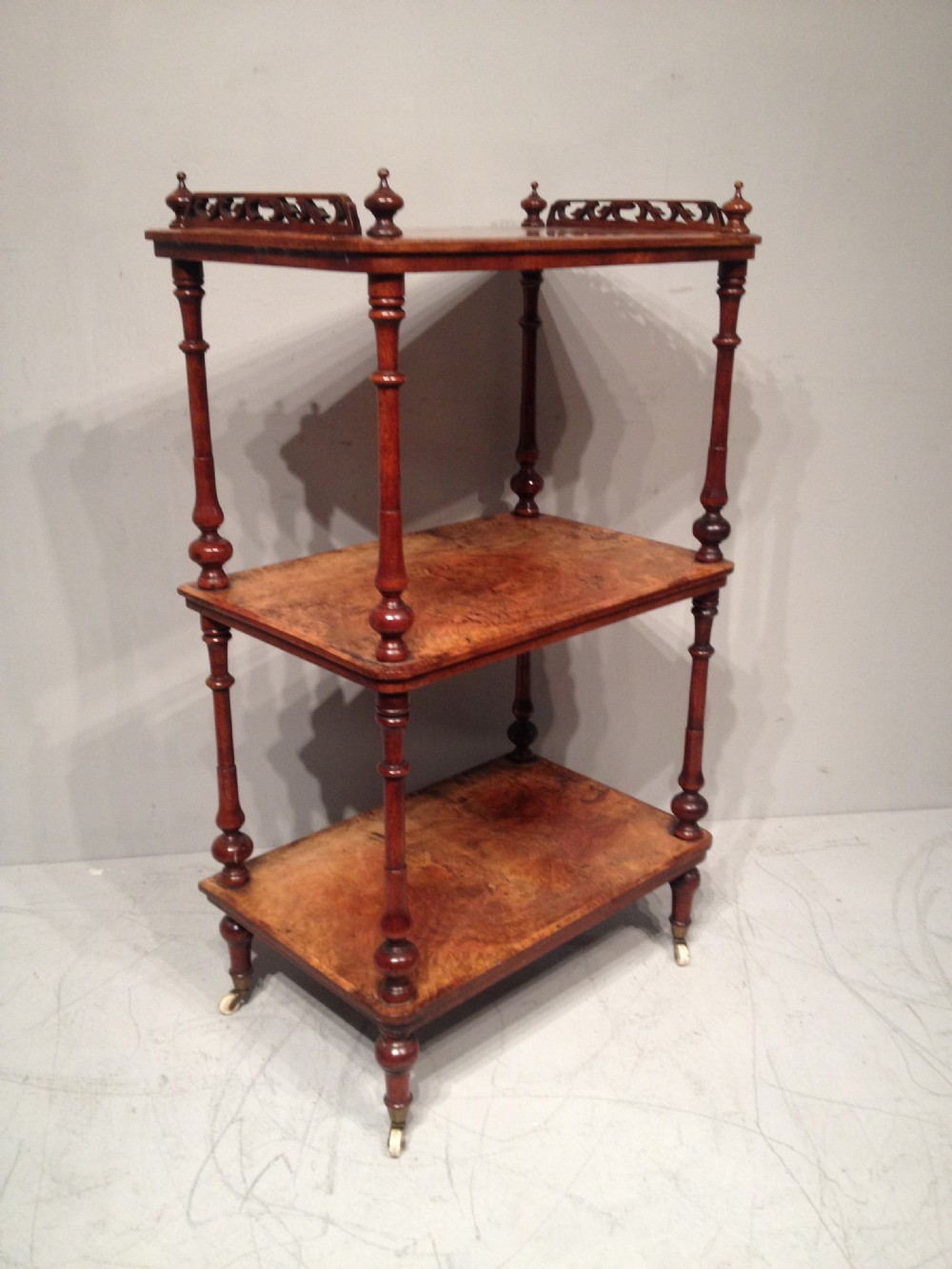 a victorian burr walnut three tier whatnot