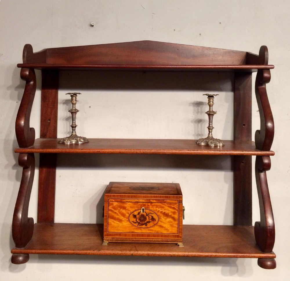 set of regency mahogany hanging shelves