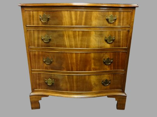 mahogany serpentine four drawer chest of drawers