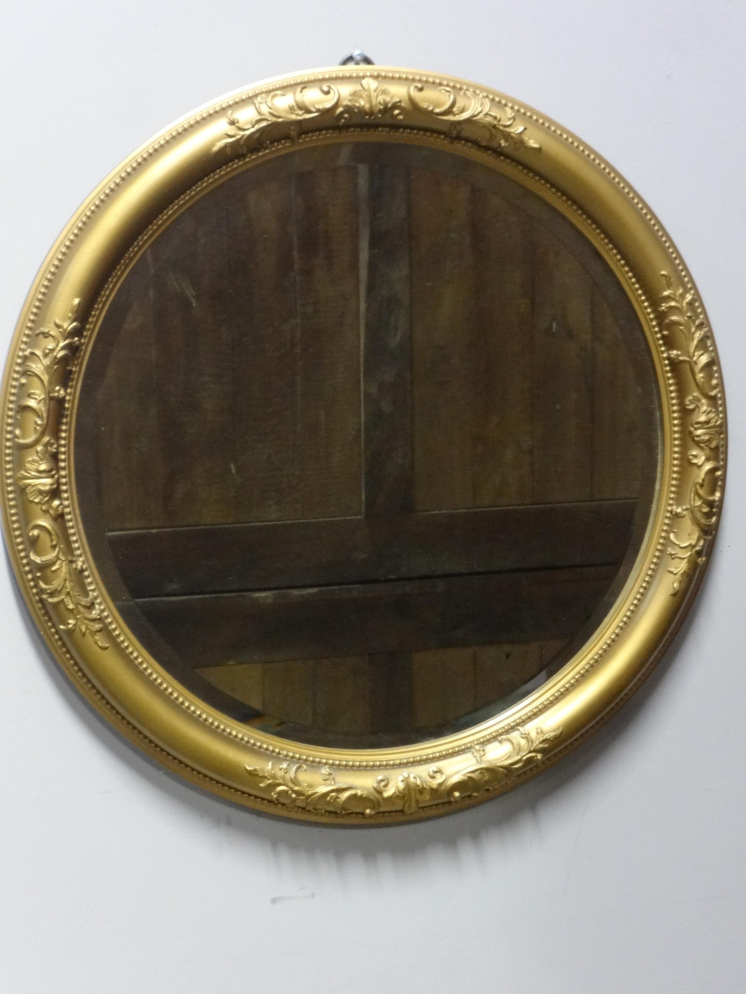 good round gilt mirror