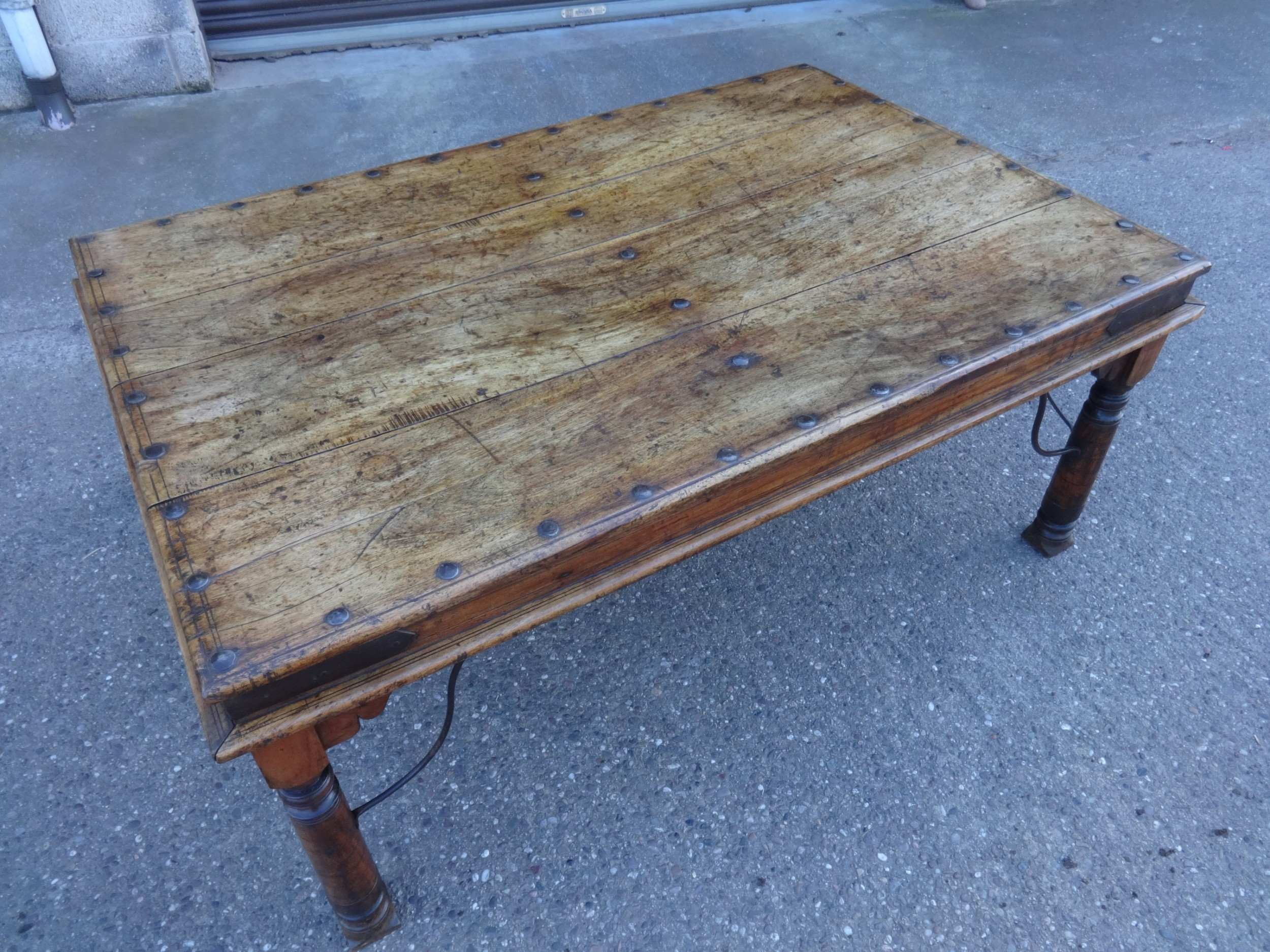 a superb iron and teak dining table
