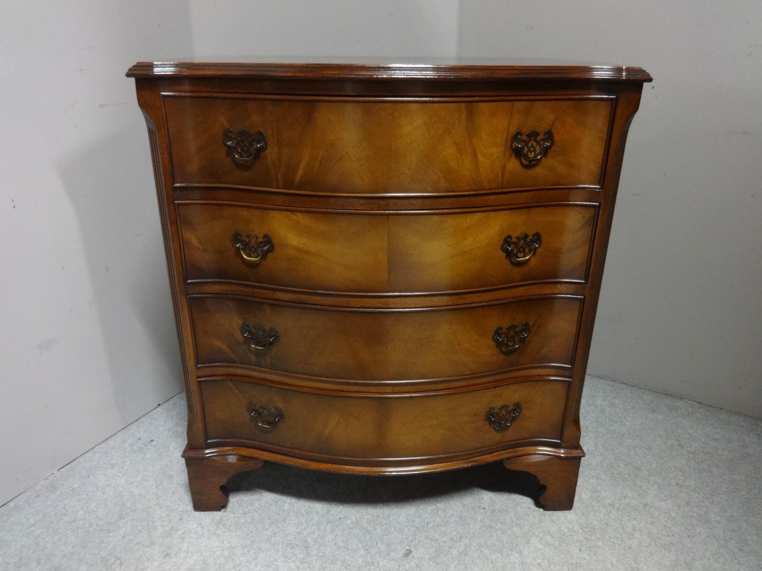 four drawer serpentine chest