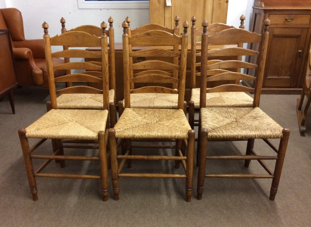 set of six 19th century oak ladder back country chairs