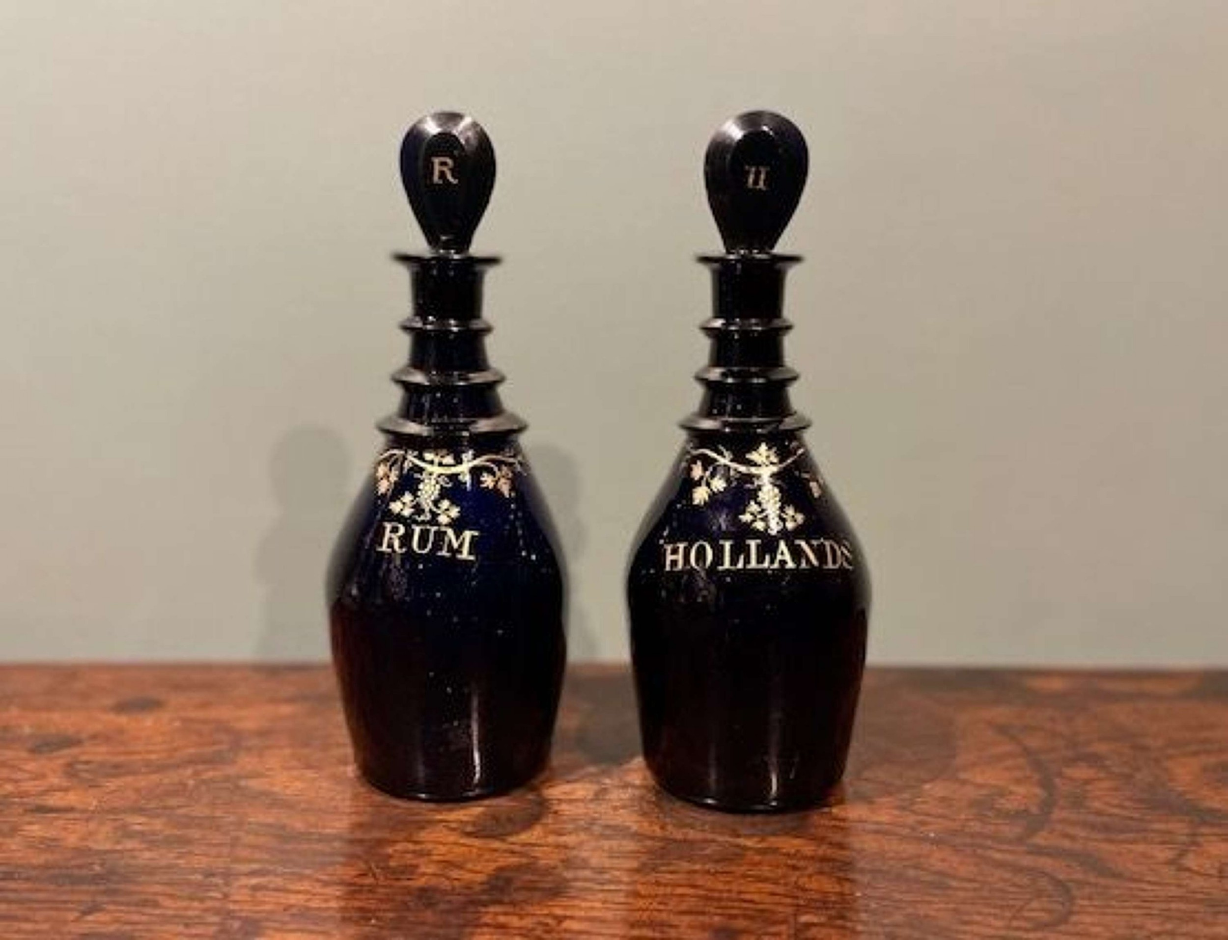 a pair of regency 'bristol blue' spirit decanters rum and hollands