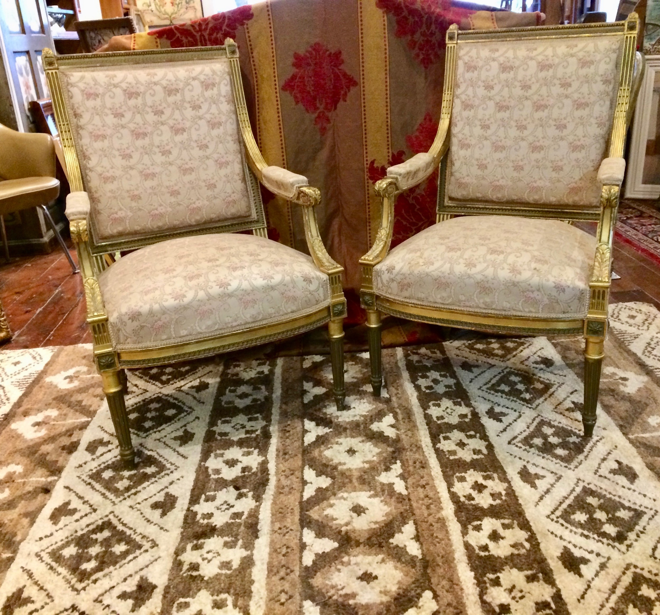 a pair of french open elbow chairs 19th century