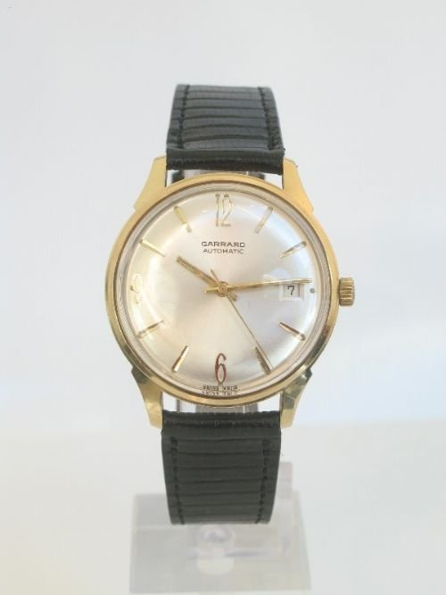 outstanding solid 9ct gold garrard automatic mens watch