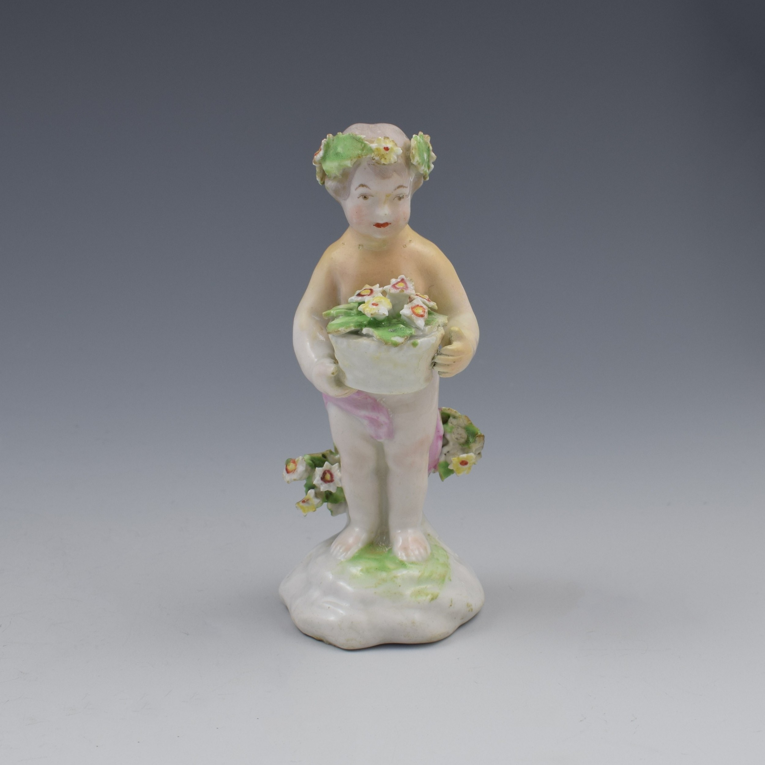 18th century derby porcelain figure of a small putto c1780
