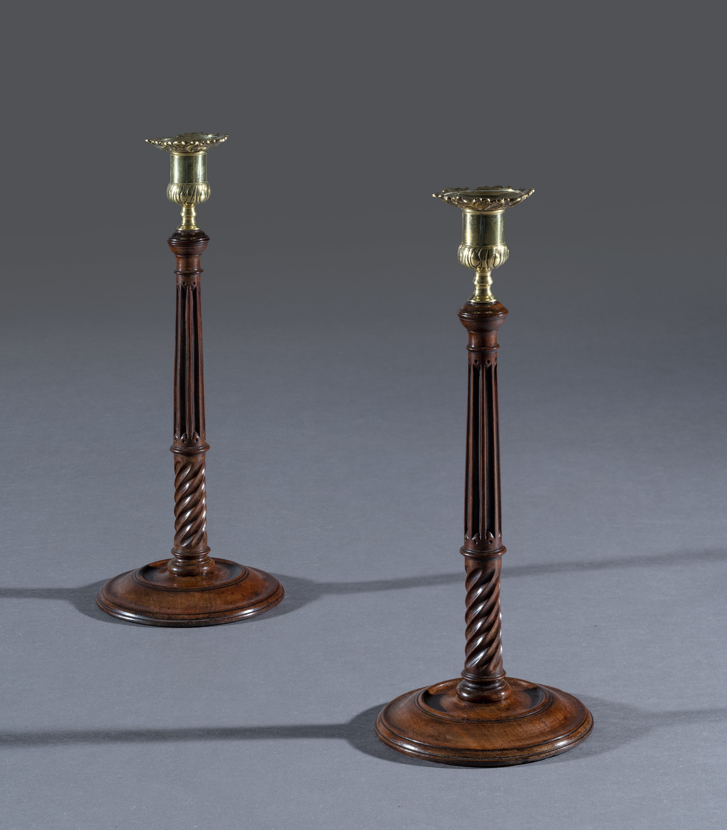 pair of 18th century mahogany candlesticks