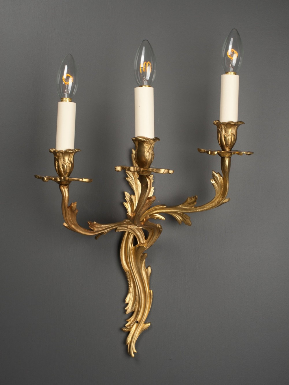 pair of three branch gilt rococo wall sconces
