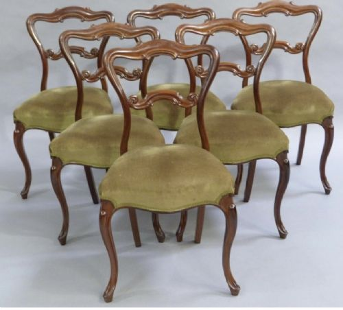 a set of six very fine mahogany balloon backed cabriole legged dining chairs in very good order