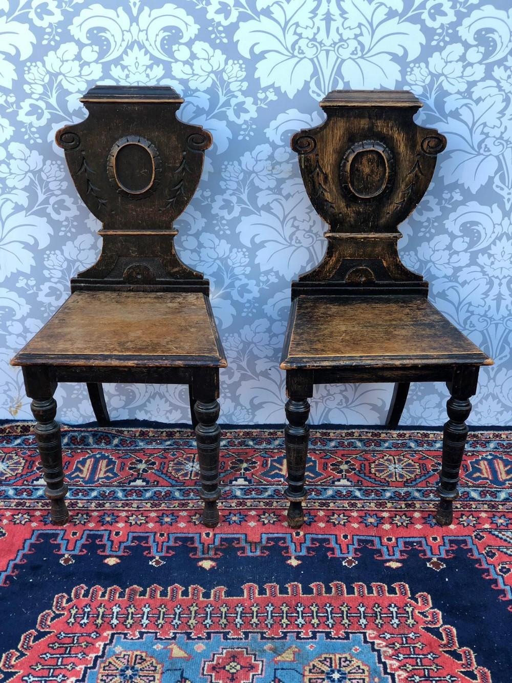 a pair of victorian oak shield shaped back hall chairs original