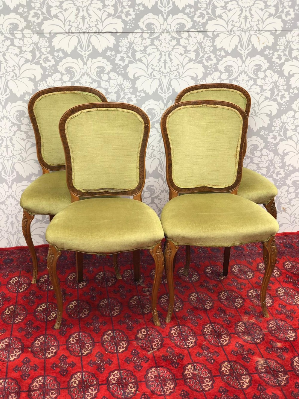 a set of four french walnut framed upholstered chairs with cabriole legs