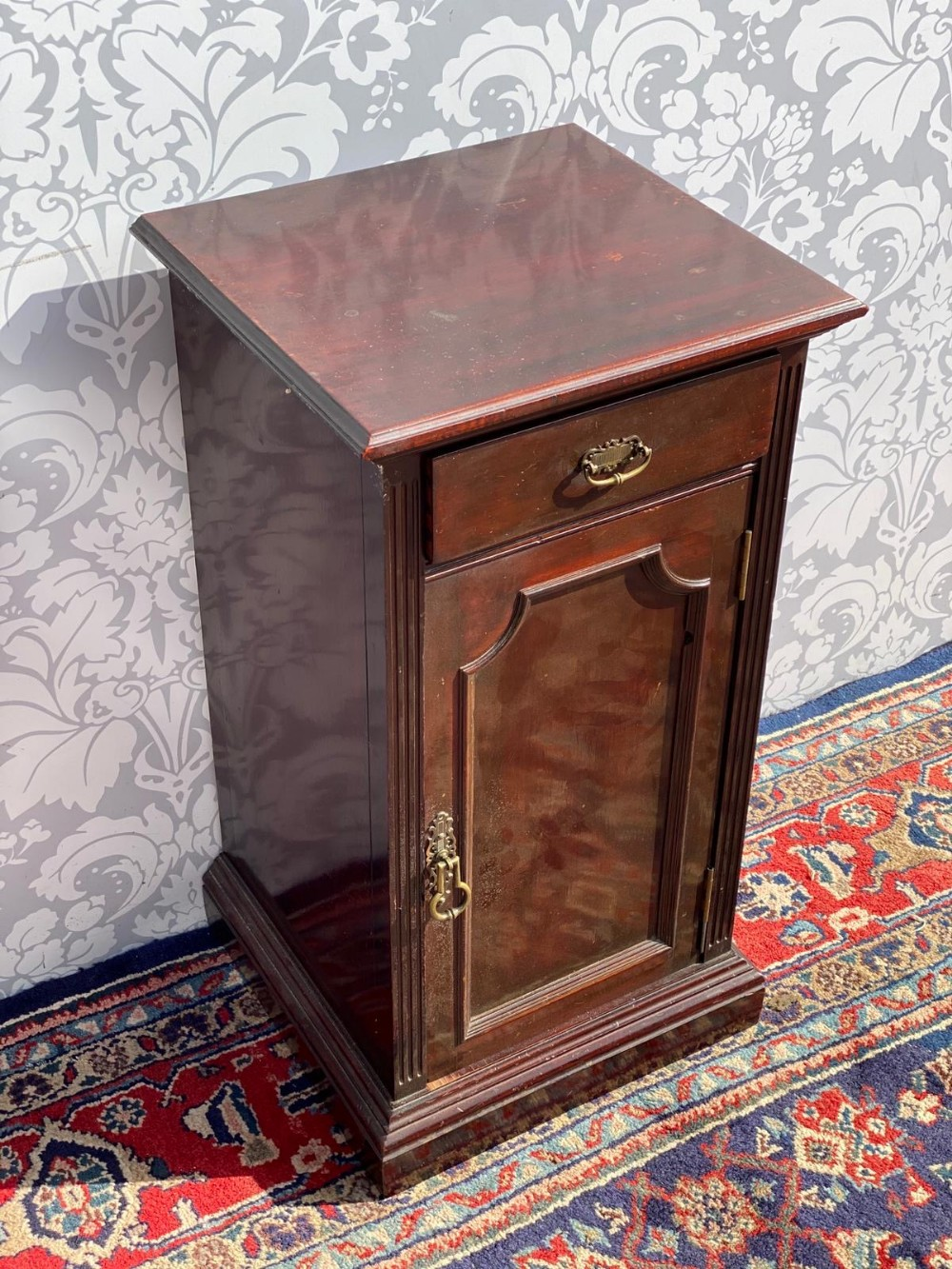 solid mahogany edwardian bedside cabinet with single door and drawer