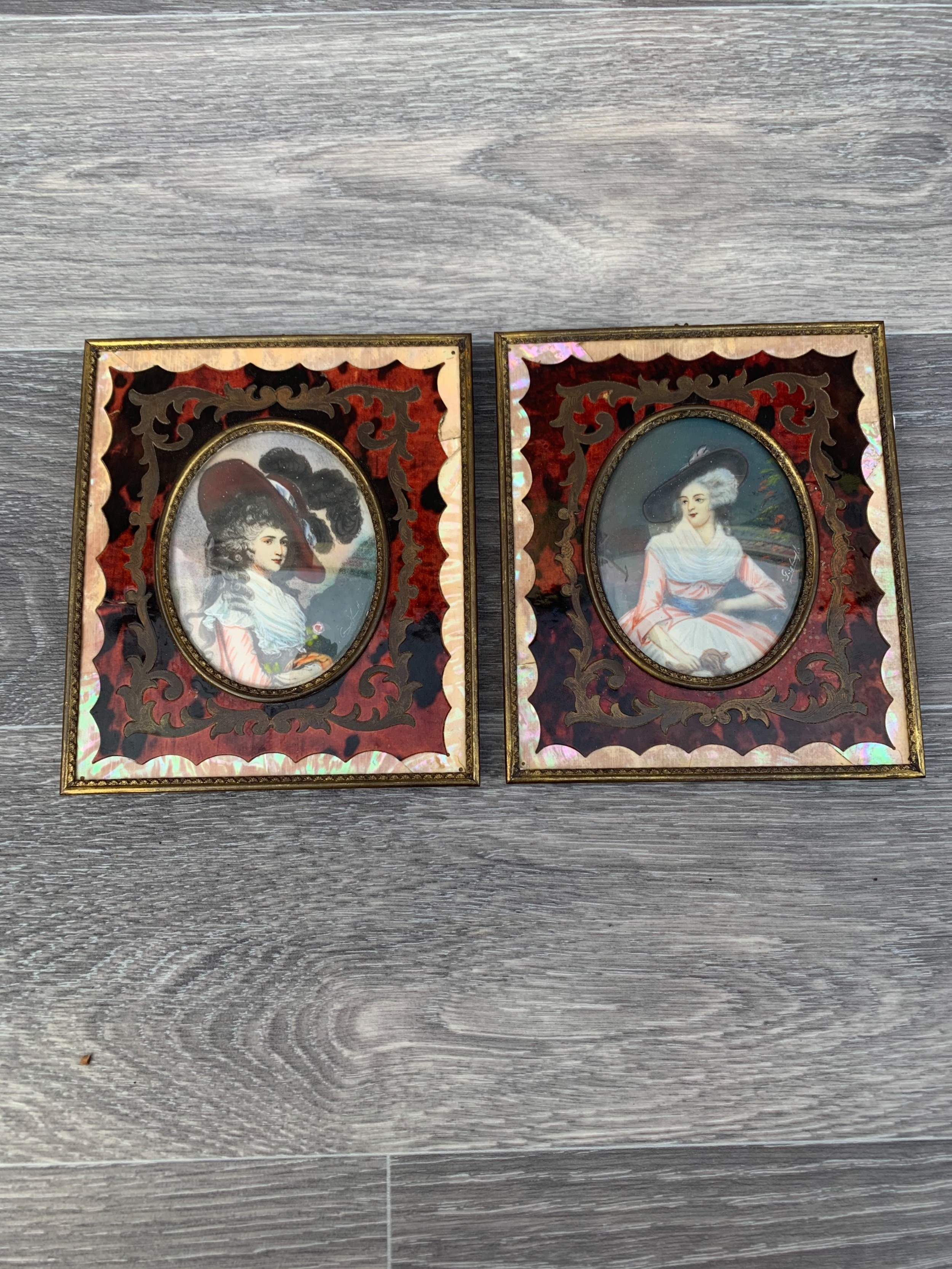 a superb quality pair of singed hand painted portraits with french boulle and mother of pearl inlay frames stunning all original