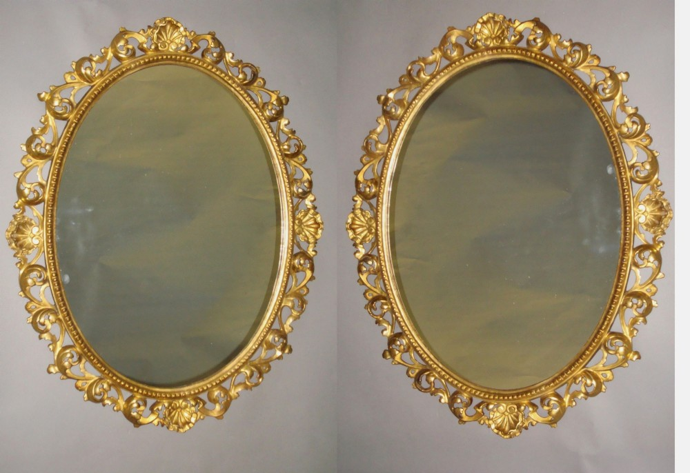 a mid c19th pair of florentine carved giltwood wall mirrors