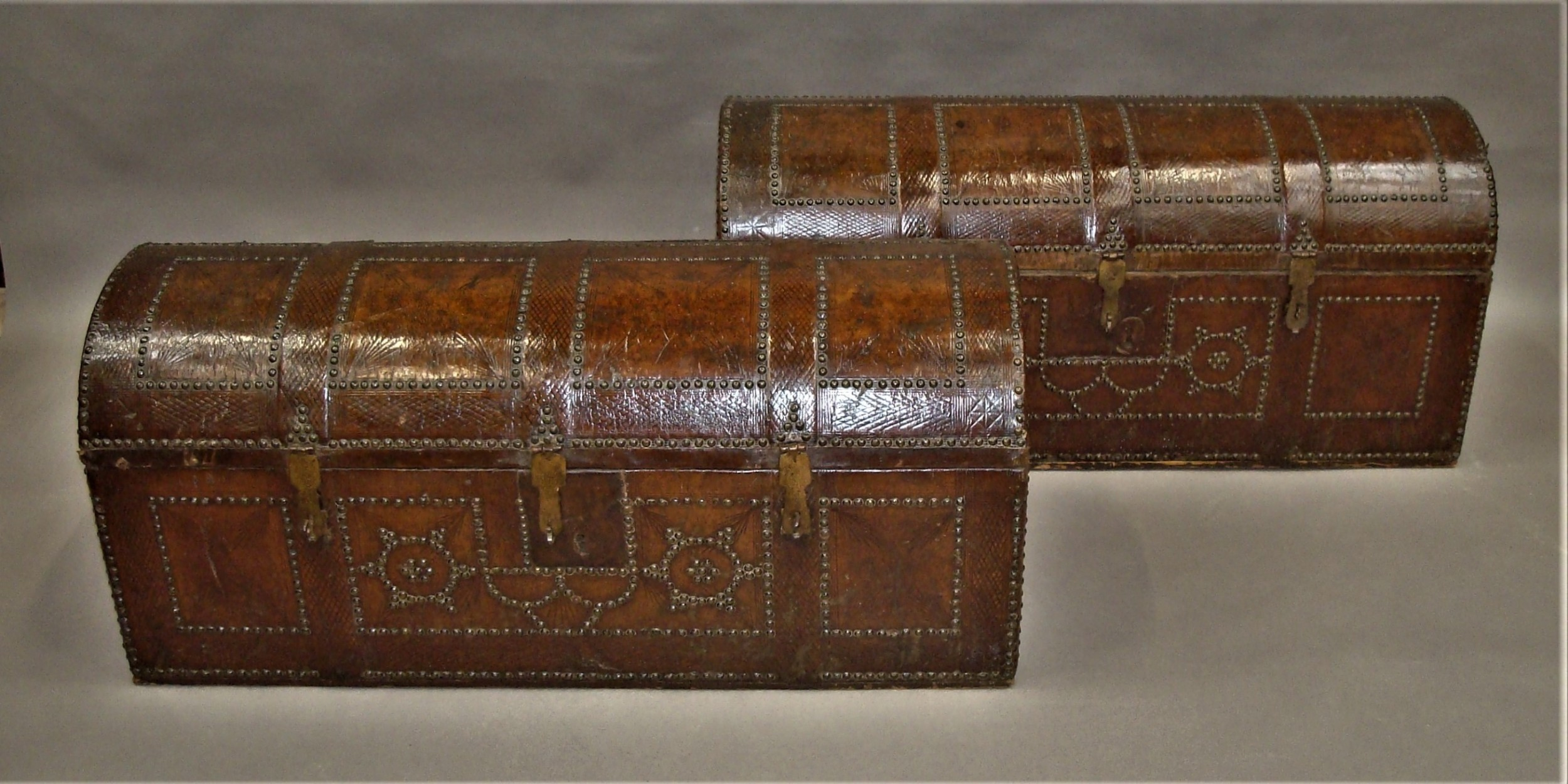 c18th pair spanish leather trunks