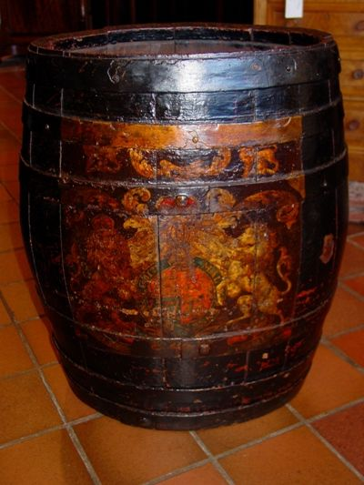 a mid19th century royal navy oak and iron bound ovoid shaped barrel with painted royal coat of arms