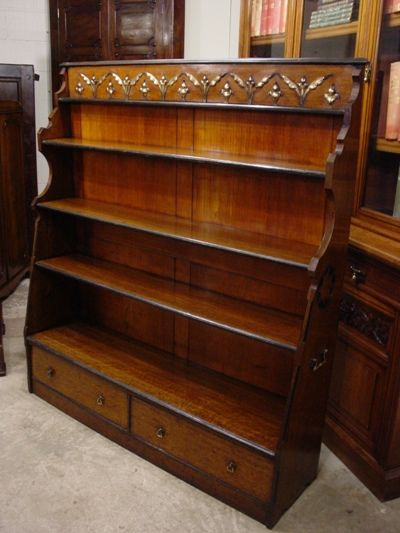 an unusual late victorian aesthetic movement oak waterfall bookcase circa 1890
