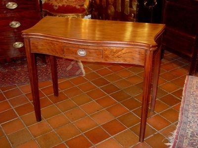 a late 18th century george iii serpentine form foldover tea table circa 1780