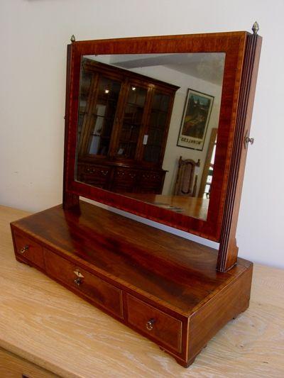 an early 19th century george iii figured mahogany toilet mirror circa 1810