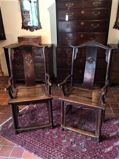 a pair of late 19th chinese elm elbow chairs