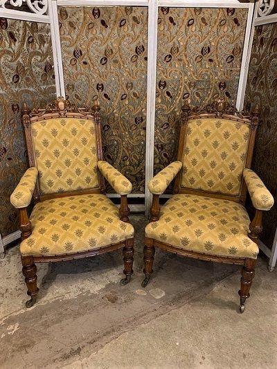 a good pair of mid victorian gothic oak open armchairs