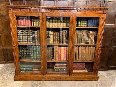 a late victorian mahogany 3 door glazed bookcase with carved roundels and fluted line decoration