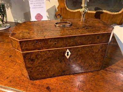 an early 19th century yew wood box which originally would have been a tea caddy