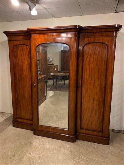 a good late victorian figured mahogany breakfronted triple wardrobe