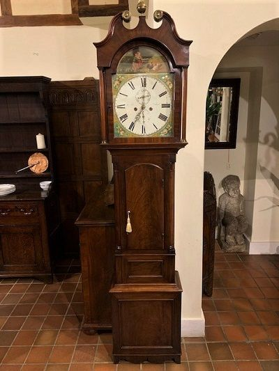 an early 19th century figured mahogany scottish longcase clock of relatively small proportions with beautiful painted dial depicting children and poultry