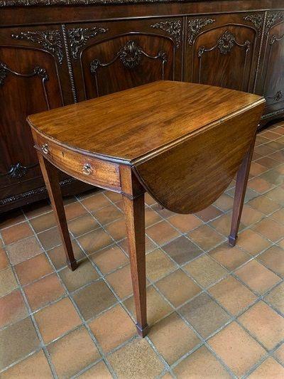 an early 19th century george iii mahogany oval pembroke table