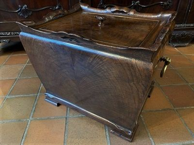 an unusual early victorian beautifully figured mahogany sarcophagus shaped storage box cellarette