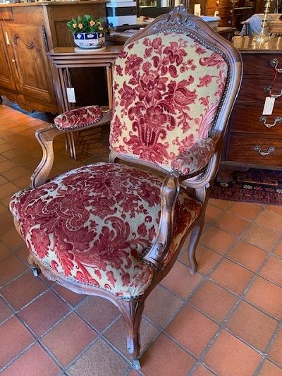 an early 20th century french louis xv style walnut open armchair fauteuil on slender cabriole legs circa 1910