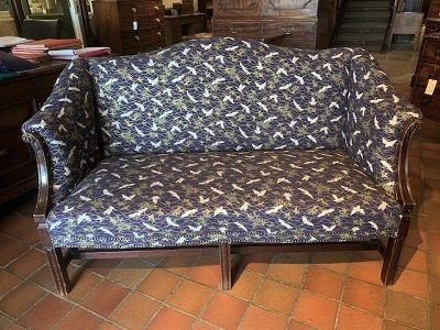 an early 19th century mahogany camelback sofa of small proportions circa 1830