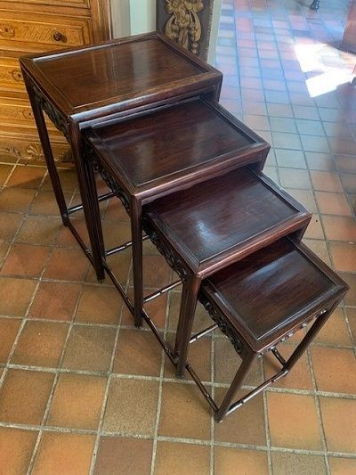 an early 20th century nest of four chinese rosewood tables circa 1920