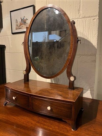 a george iii mahogany bow fronted toilet mirror of small proportions circa 1810