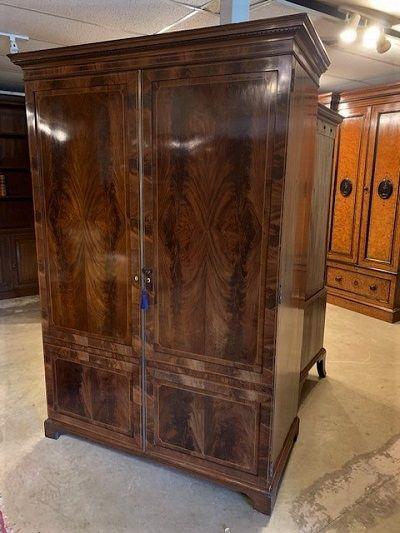 an edwardian figured mahogany double wardrobe with inlaid boxwood and ebony line stringing detail circa 1910